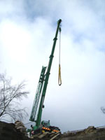 Crane used to lift beams and door lintel in place