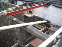 First floor joists in place and steel bar to support roof
