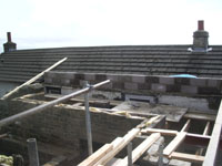 Roof walling built up to tie in roof to existing house