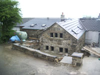 Scaffolding down and dry-stone wall built to compliment the house